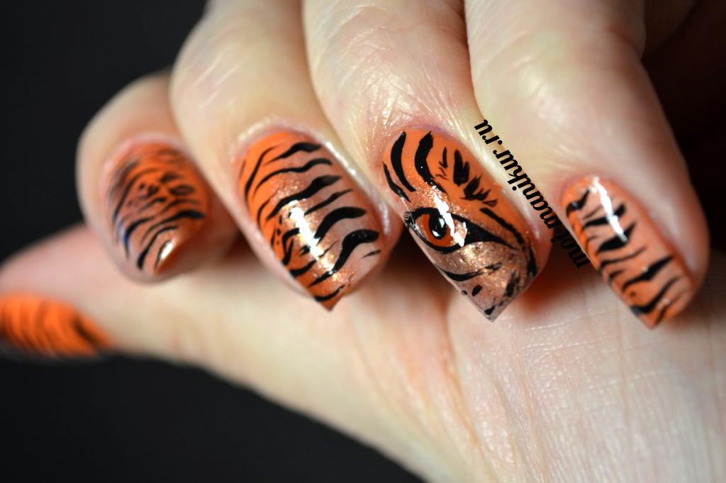 Дизайн ногтей тигровый