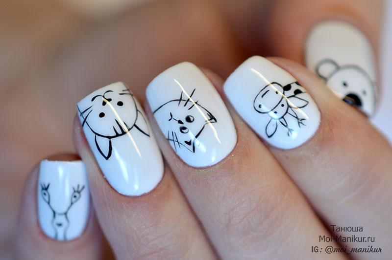 Рисунки животных на ногтях